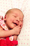 Adorable sleeping newborn baby girl Stock Photo