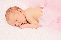 Adorable sleeping newborn baby girl Stock Images