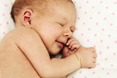 Adorable sleeping and smiling newborn baby girl Royalty Free Stock Image