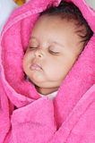 Adorable sleepy girl. A over pink  background Royalty Free Stock Photos