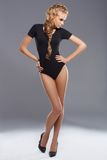 Adorable and slim blond woman posing angainst dark Royalty Free Stock Image