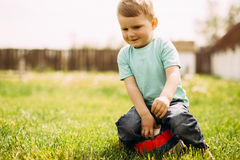 Adorable small boy playing with a soccer ball Stock Images