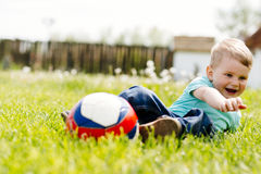 Adorable small boy playing with a soccer ball outdoors Royalty Free Stock Image