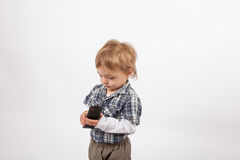 Adorable small boy with a tv remote control Royalty Free Stock Images