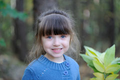 Adorable small girl in the autumn forest Royalty Free Stock Photo