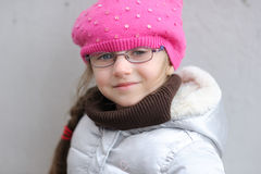 Adorable small girl in bright pink hat Royalty Free Stock Photos