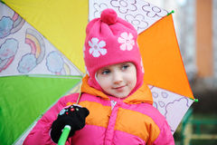 Adorable small girl in colorful clothers Royalty Free Stock Photography
