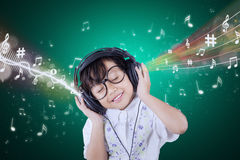 Adorable small girl enjoy music with headphones Royalty Free Stock Photography