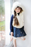 Adorable small girl in white fur hood Royalty Free Stock Photo