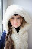 Adorable small girl in white fur hood Stock Photography