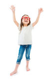 Adorable small girl in a white T-shirt. Adorable trendy hipster kid lifted hands upwards and laughs. White tshirt jeans and glasses frame, White background royalty free stock photography
