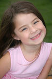 Adorable Smile. Beautiful 5 year old girl with a great smile Stock Photos
