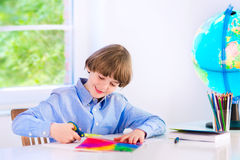 Adorable smiling boy doing homework Royalty Free Stock Image