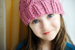 Adorable smiling child girl in pink knitted hat Royalty Free Stock Photo