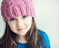 Adorable smiling child girl in pink knitted hat Royalty Free Stock Photos