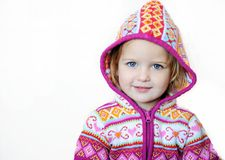 Adorable smiling child girl wearing pink jacket Stock Photos