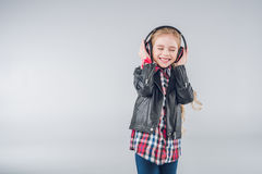 Adorable smiling girl with closed eyes wearing headphones Royalty Free Stock Photos