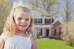 Adorable Smiling Girl Playing in Front Yard. Cute Smiling Girl Playing in Front Yard of House Royalty Free Stock Image