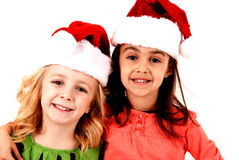 Adorable smiling girls in christmas santa hats Stock Image