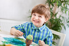 Adorable smiling happy child boy painting Stock Photo