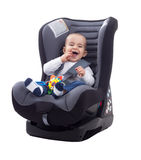 Adorable smiling happy child sitting in a car seat Stock Images