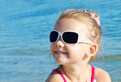 Adorable smiling little girl on beach vacation Stock Image