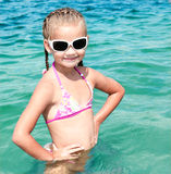 Adorable smiling little girl on beach vacation Stock Photos