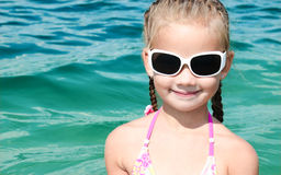 Adorable smiling little girl on beach vacation Royalty Free Stock Photo
