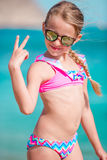 Adorable smiling little girl on beach vacation stock photography