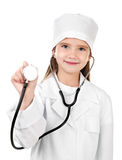 Adorable smiling little girl dressed as a doctor Stock Photo
