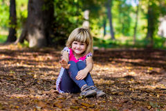 Adorable smiling little girl greeting waving her hand Stock Images