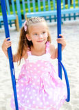 Adorable smiling little girl having fun on a swing Royalty Free Stock Photography