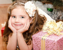 Adorable smiling  little girl lying on floor Royalty Free Stock Photos