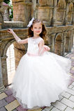 Adorable smiling little girl in princess dress. Outdoor Royalty Free Stock Photo