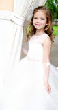 Adorable smiling little girl in princess dress Stock Images