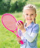 Adorable smiling little girl with racket and ball Royalty Free Stock Photo
