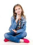 Adorable smiling  little girl sitting on a floor Stock Photos