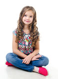 Adorable smiling  little girl sitting on a floor Royalty Free Stock Photos