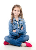 Adorable smiling  little girl sitting on a floor Royalty Free Stock Photography