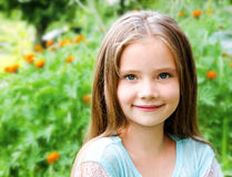Adorable smiling little girl in summer day Stock Images