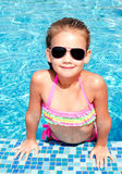 Adorable smiling little girl in swimming pool stock photos