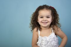 Girl in white dress on blue background royalty free stock image