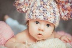 Adorable smiling newborn baby girl lies in basket Royalty Free Stock Image