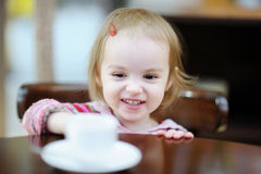 Adorable smiling toddler girl at cafe Royalty Free Stock Image