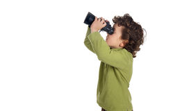 Adorable spy boy with binoculars Stock Photo