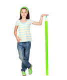 Adorable student girl with a giant green pencil Royalty Free Stock Photos