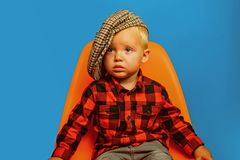 Adorable and stylish. Small child. Boy child with fashion look. Small baby in fashionable wear. Fashion boy. Adorable. Fashionist. Childrens fashion trends stock images