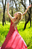 Adorable summer young woman in long red dress Stock Photo
