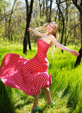Adorable summer young woman in long red dress Royalty Free Stock Photo