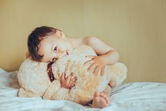 Adorable sweet baby with teddy bear Stock Photo